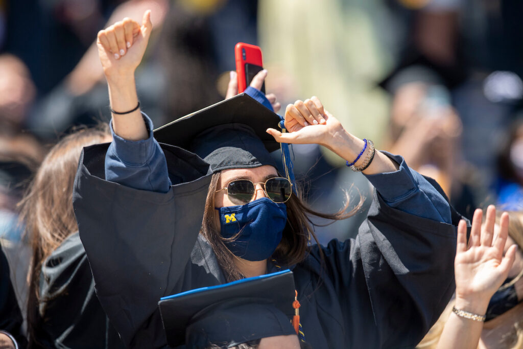 Female Grad with M mask