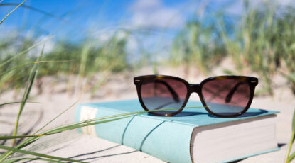 Sunglasses and book at the beach