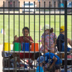 Kids watch the MMB practice at Elbel Field