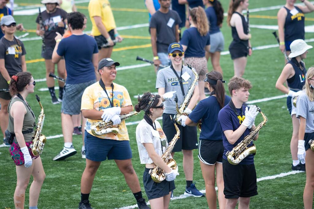 Happy band members practice on the field 2021