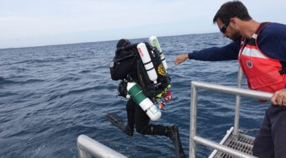 Researcher jumps into Lake Huron