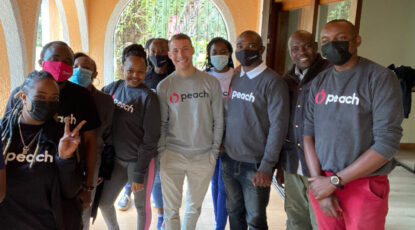 Zachary Petroni (center), U-M's first Wallenberg Fellow, is shown with team members from Peach, an automotive marketplace he founded in Nairobi, Kenya, following his 2013 fellowship. (Photo courtesy of Zachary Petroni)