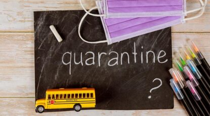 """A chalkboard with the word """"Quarantine"""" written on it."""
