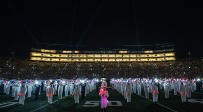 The Michigan Marching Band on 9/11/21 lit up the field in a night-time halftime tribute.