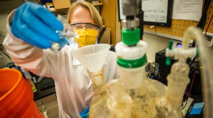 Renata Rae Strarostka, a graduate research assistant, works in the lab.
