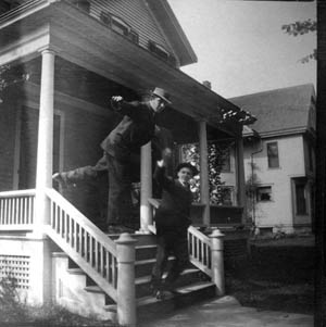 Male roomers on the porch of their house. President Little's survey of rooming house life found (to no one's surprise) that such houses were 'often of a non-intellectual character.'