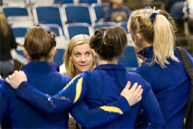 Head Coach Bev Plocki talks to the team at a meet against Iowa in February. In her 19 years at Michigan, Plocki has led the Wolverines to 15 Big Ten titles. (Photo: Scott Soderberg, U-M Photo Services.)