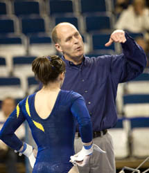 Assistant coach Scott Sherman, a former National Assistant Coach of the Year, is an invaluable advisor, especially on the uneven bars and vault. (Photo: Scott Soderberg, U-M Photo Services.)