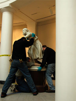 Workers return 'Nydia' to her home in the original wing of the University of Michigan art museum. (Photo courtesy U-M Museum of Art.)