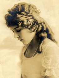 Mary Pickford, 'America's Sweetheart' and one of Hollywood's greatest stars and most powerful women, made her film debut in 1909.