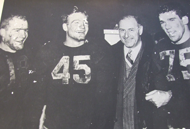 By 1947, Crisler's 'spindly-legged freshmen' had matured into the Mad Magicians, one of the most powerful teams ever assembled. (left to right: Bump Elliott, Pete Elliott, Crisler and Bruce Hilkene. Photo courtesy U-M Bentley Historical Library.)