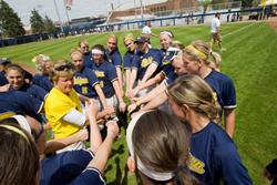 Carol Hutchins and the University of Michigan softball team
