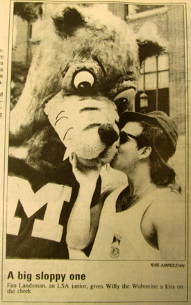 Michigan Daily photograph of Willy the Wolverine goofing around with a Michigan student