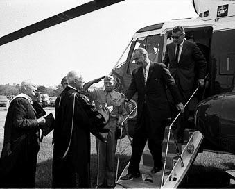 Gov. George Romney greets LBJ as he descends from the helicopter. (Image courtesy of U-M Bentley Historical Library.)