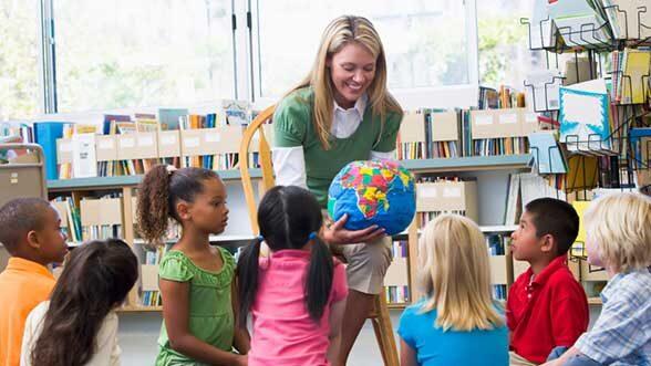 Teacher with kids, stock
