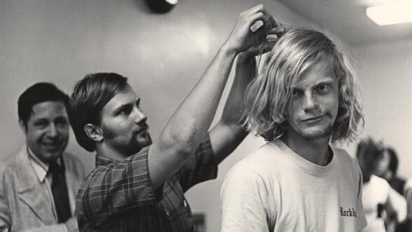 Ensian photo of a long-haired kid getting a haircut