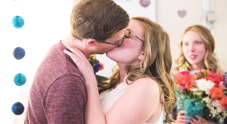 Bridge and Groom kiss at Michigan Medicine Wedding