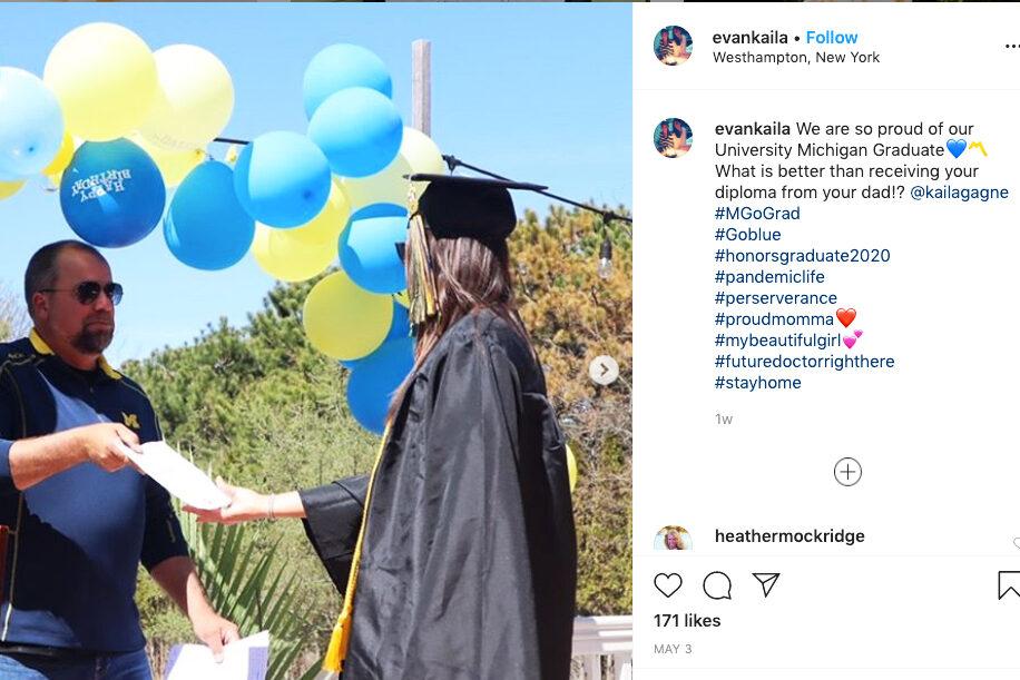 Dad presents diploma to grad