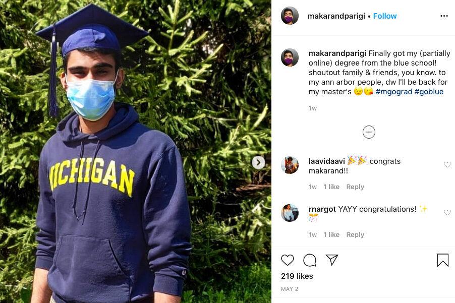 Grad with mask at bush