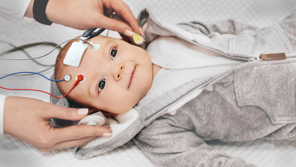 Baby with electrodes