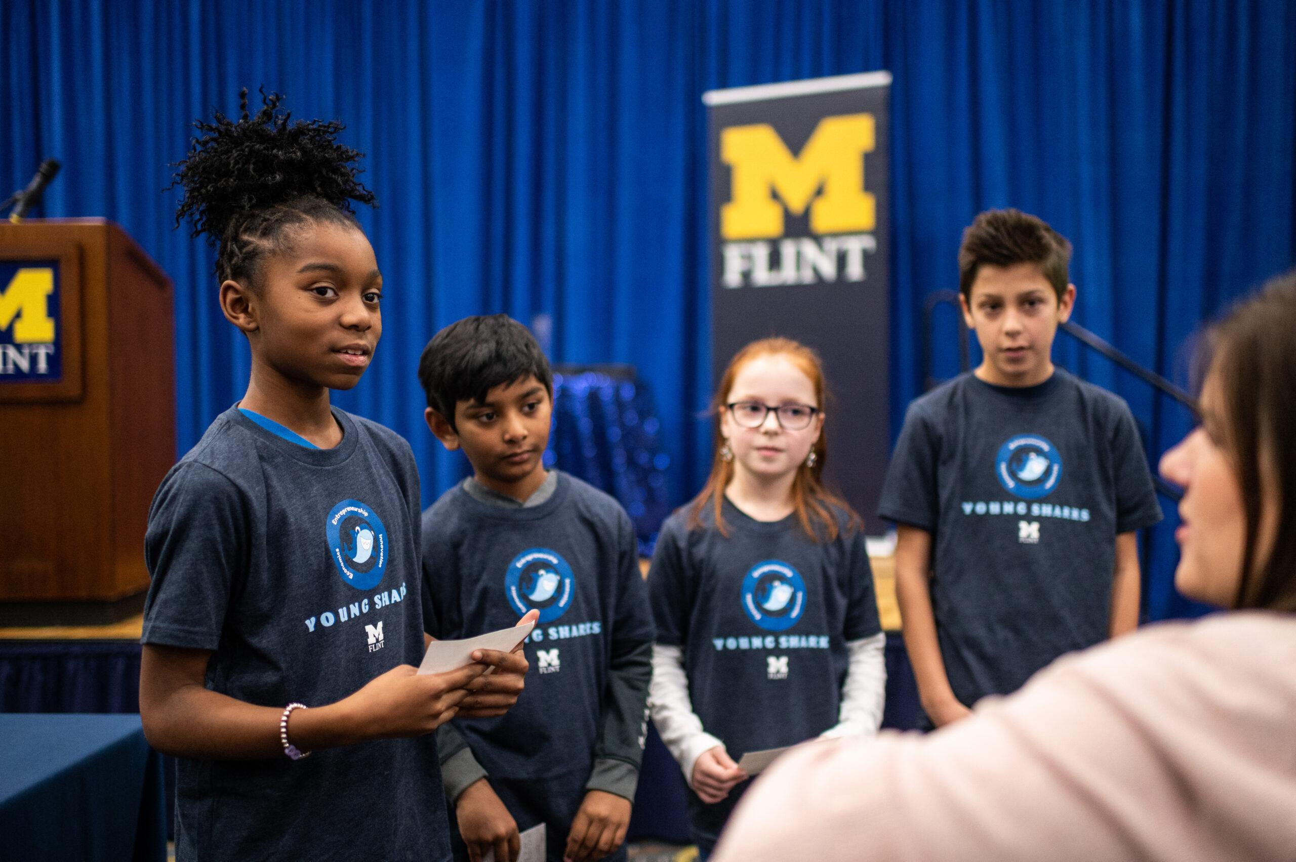 Students from Mason Elementary School of Grand Blanc Community Schools discuss their presentation strategy.