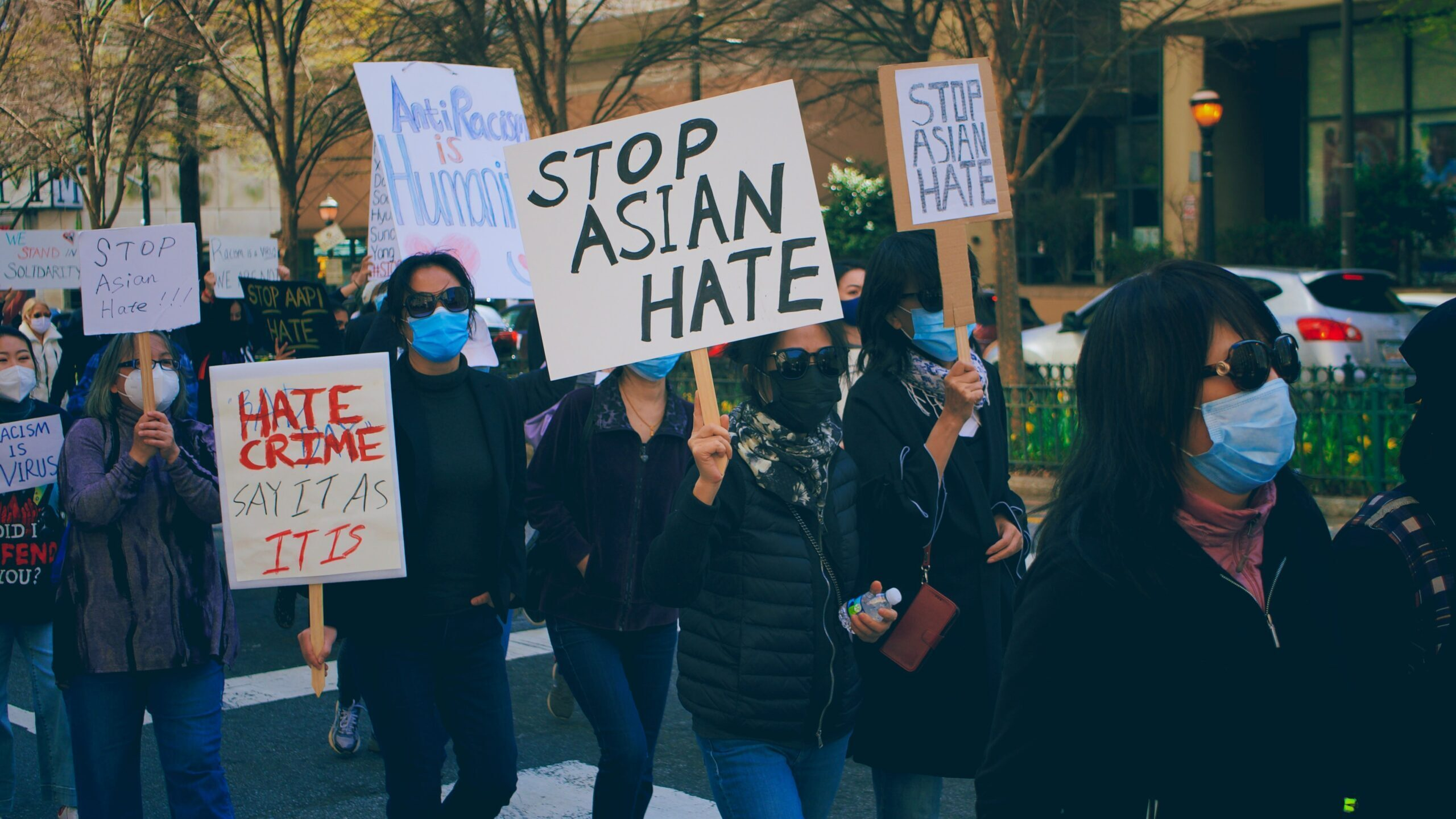 """Marchers carry """"Stop Asian Hate"""" signs"""