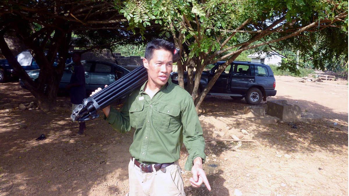 Richard Lui carries camera