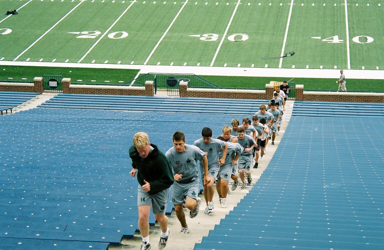 Athletes run the stairs in Michigan Stadium