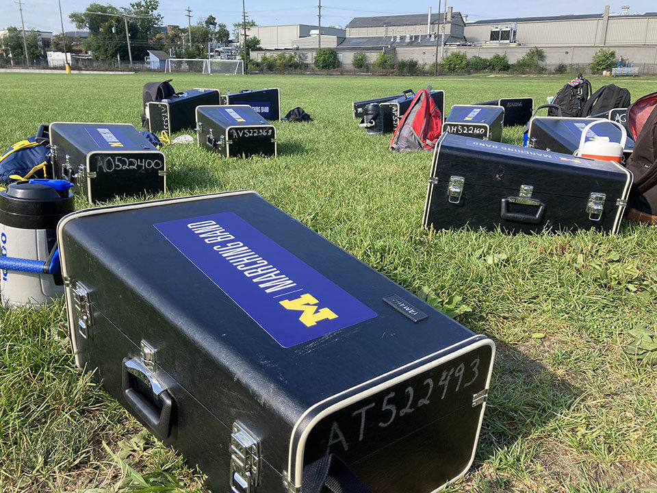 Michigan Marching Band equipment on the ground