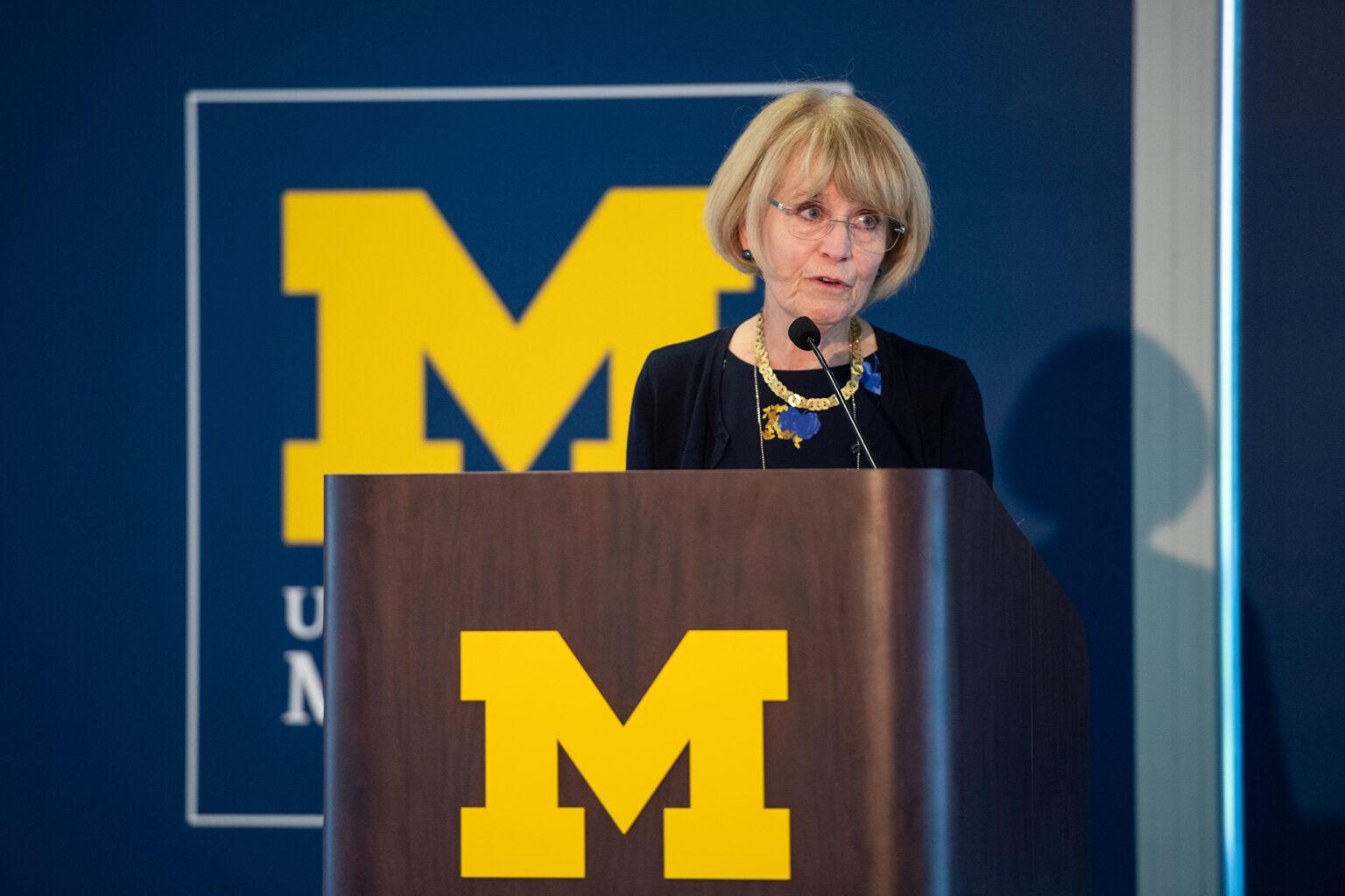 President Emerita Mary Sue Coleman speaks from the podium